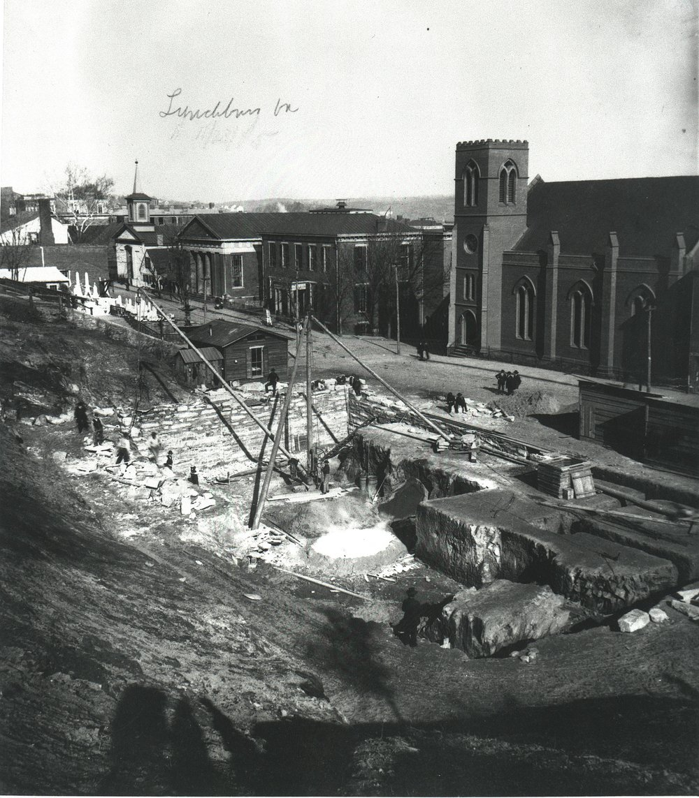 Church Street between 8th and 10th Streets ca. 1885 showing progress on the construction of the new United States Court House and Post Office (Monument Terrace building). Just to the left of the construction site, you can see the steps of Monument Terrace.