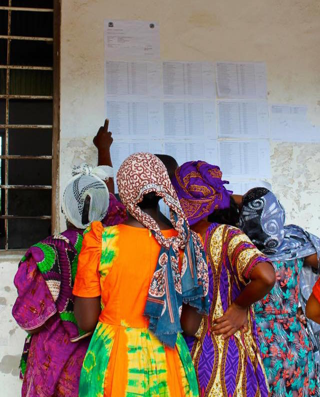 Women voters look for their names in the on the voter list in Kinondoni, Dar es Salaam.