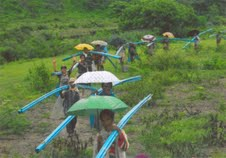 carrying supplies- Tabau village.jpg