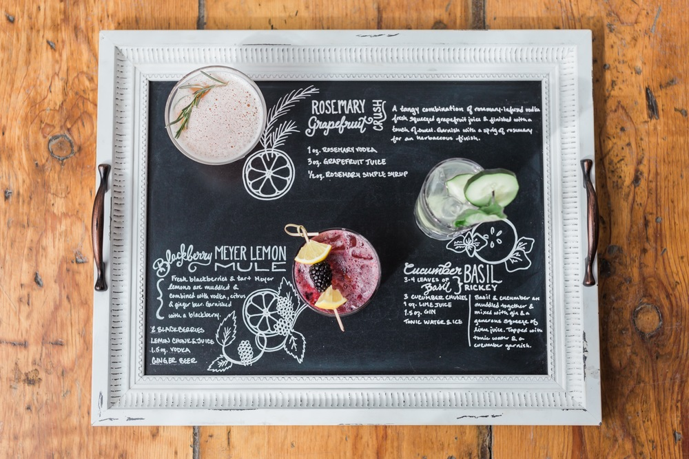 Twist created signature cocktails just for this shoot.  Here they are displayed on a tray decorated by Chalked Creative.
