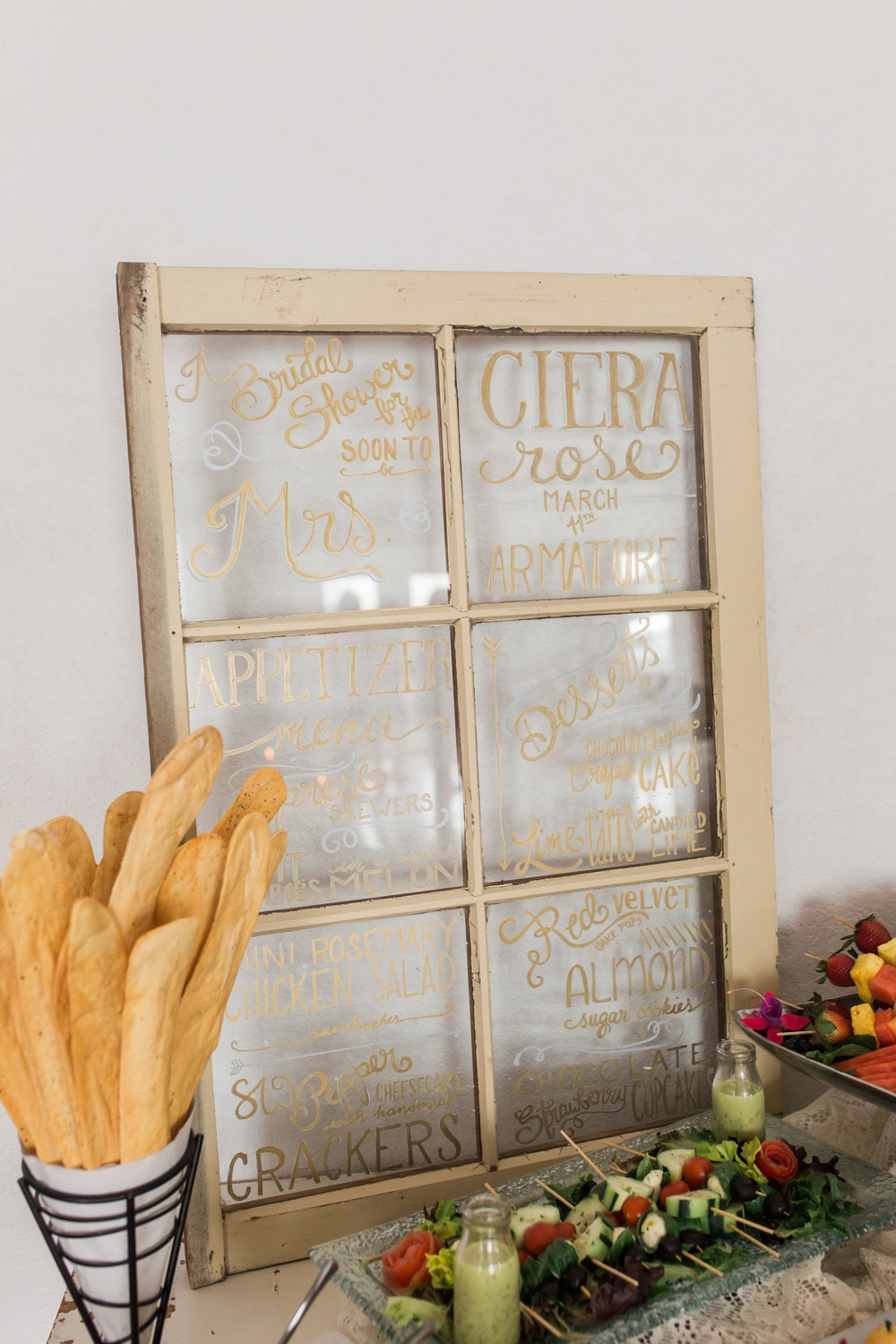 Chalked Creative made this gorgeous window pane detailing all of the menu that the ladies got to enjoy.  And just look at Tate & Tate's famous breadsticks.  Mmm-mmm.