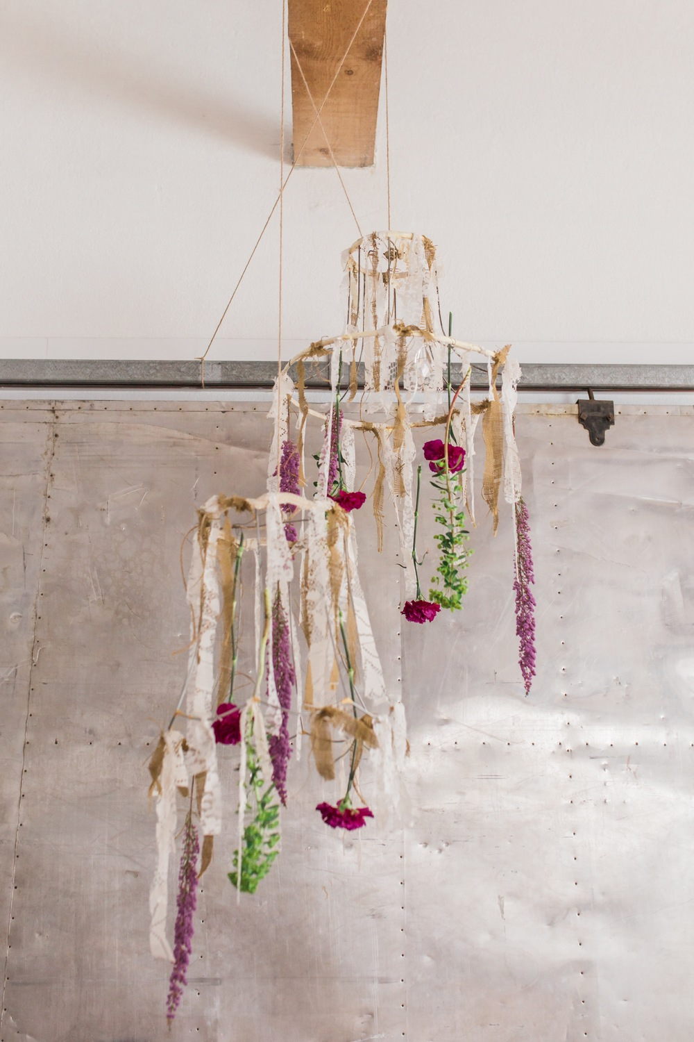 Peanut's Gallery made the chandeliers and then I got inspired and hung flowers from them. :)  Because the more flowers, the better.