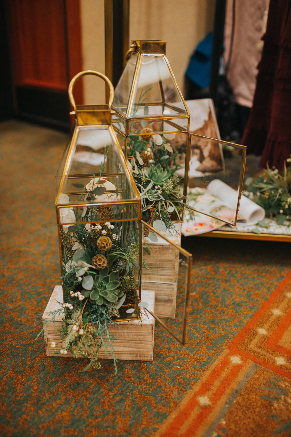 We love making terrariums out of pretty much anything, especially these modern brass lanterns.  ;)