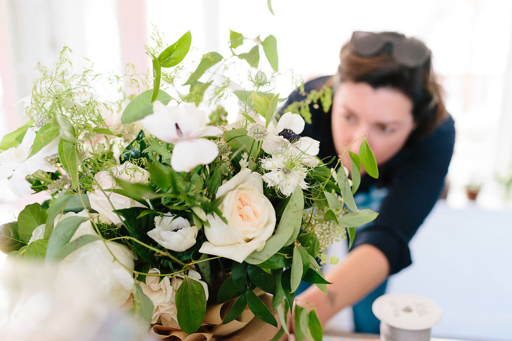 Making some last minute tweaks to the bride's bouquet.