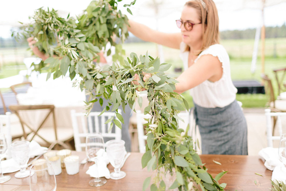 First we laid the garlands along the tables, then added lots more textural goodies to them.  Flowers came last to keep them out of the heat for as long as possible, because flowers hate heat.