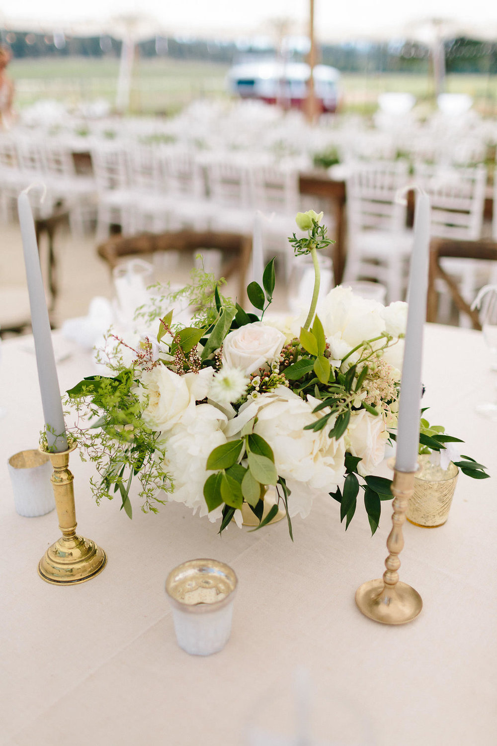 Minutes before guests arrived, the flowers came out from their cool hiding spot.  Centerpieces were placed on to the round tables.