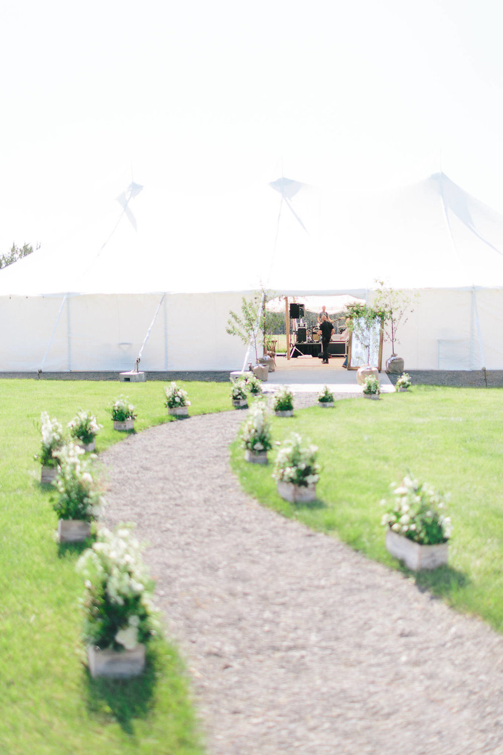 Our final task was waiting for the church team to arrive at the ranch with all of the decor that we planned on repurposing from the ceremony.  The church's living aisle became an enchanted walkway to the tent's entrance.