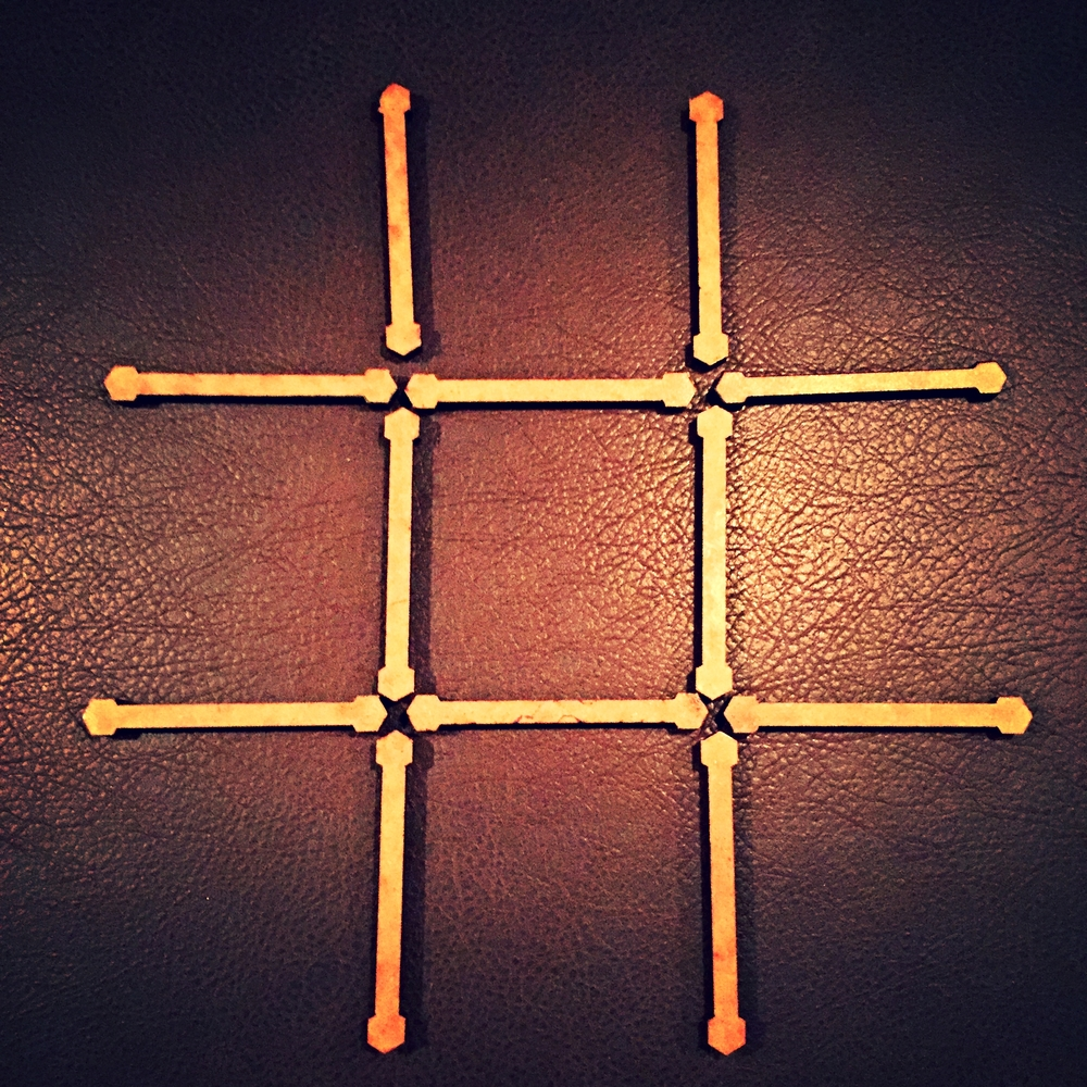 """The Merchant's """"Tic-tac-toe"""" puzzle from The Seventh Room"""