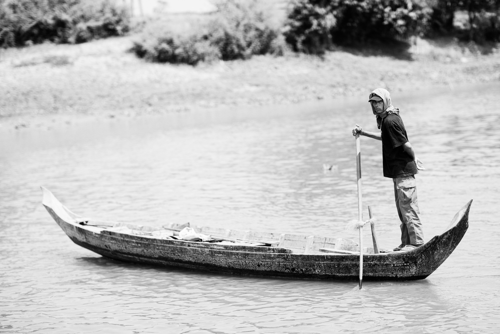 A man and his boat. Tonle Sap River, Cambodia. March 2014.