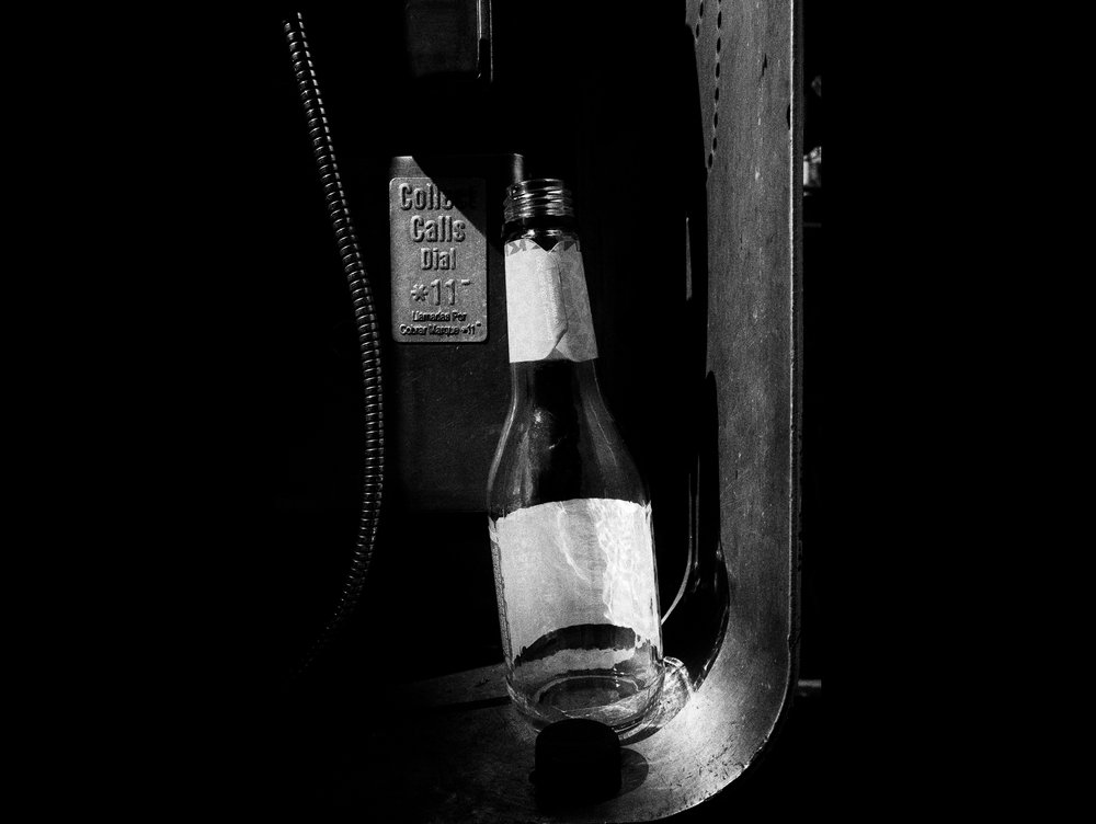Bottle in a payphone. Downtown LA.