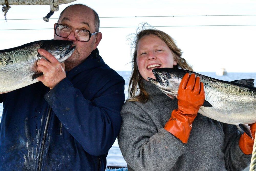Fishermen kissing fish.jpg