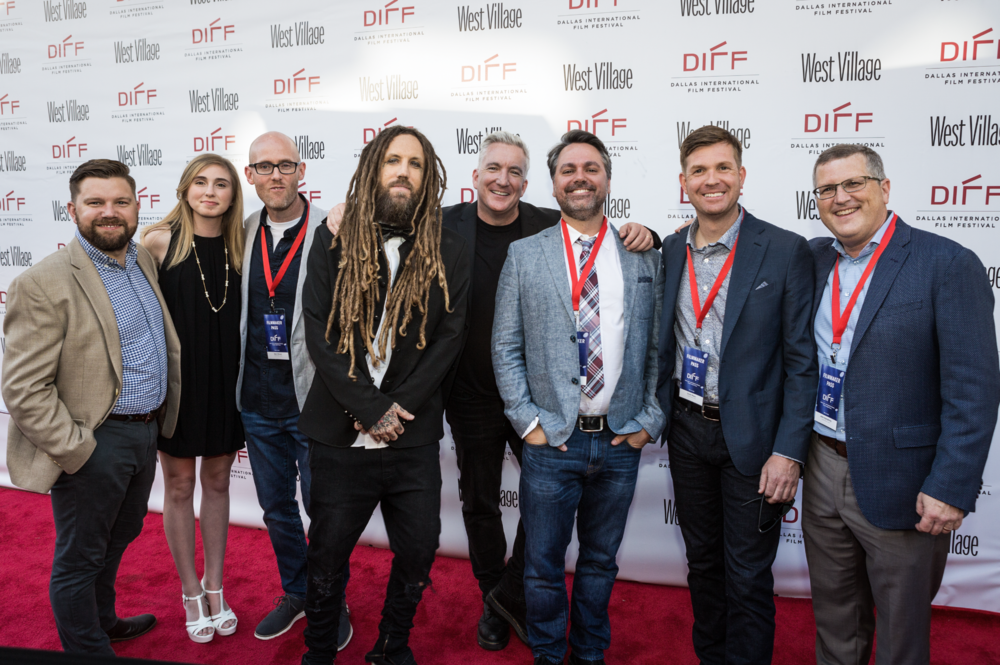 "Caption: (L to R) I Am Second President Lance Villio, Lane Ditore, Producer Sam Ditore, KoRn Founding Member Brian ""Head"" Welch, Ditore Mayo Creative Director Kevin Shivers, Director Trey Hill, Director Scott Mayo and Producer John Humphrey walk the Red Carpet at the Dallas International Film Festival prior to the Texas Premiere of ""LOUD KRAZY LOVE."""