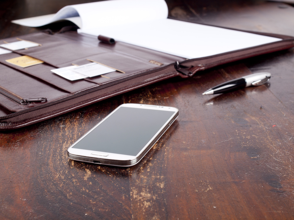 Recruitment services-leather folder phone.jpg