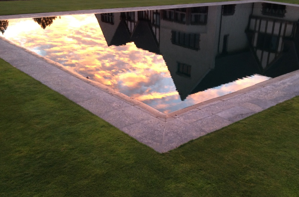 Reflection of the house in the pool at sunset.