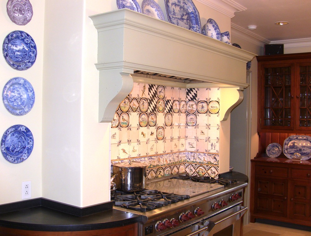 "60"" Wolf Range with grill and griddle surrounded by delft tiles."