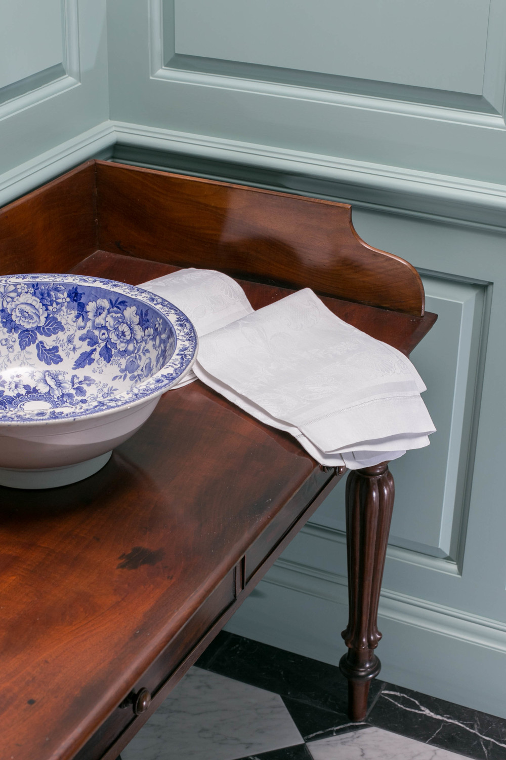 Antique mahogany washstand with an Antique blue and white basin