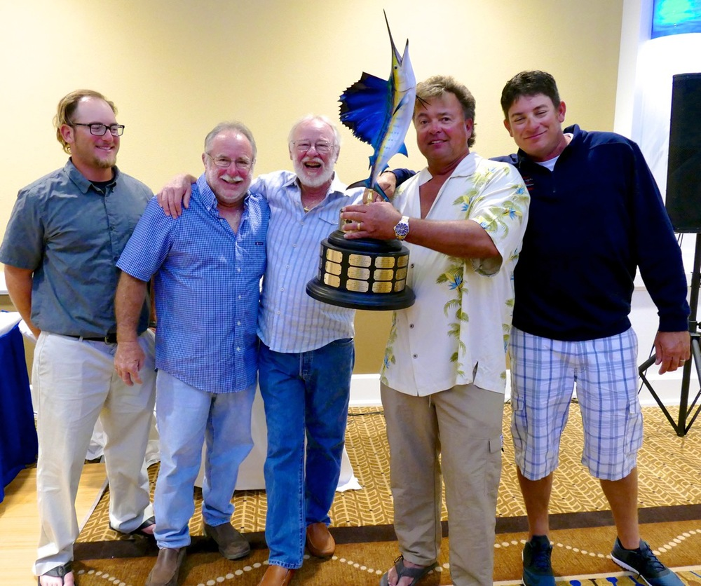 Sandy Moret of Florida Keys Outfitters presents the trophy to the winning team from the boat Kalex.   L to R Daniel Attales, Capt. Alex Adler, Sandy Moret, Scott Lund (holding trophy) and Justin Baker.
