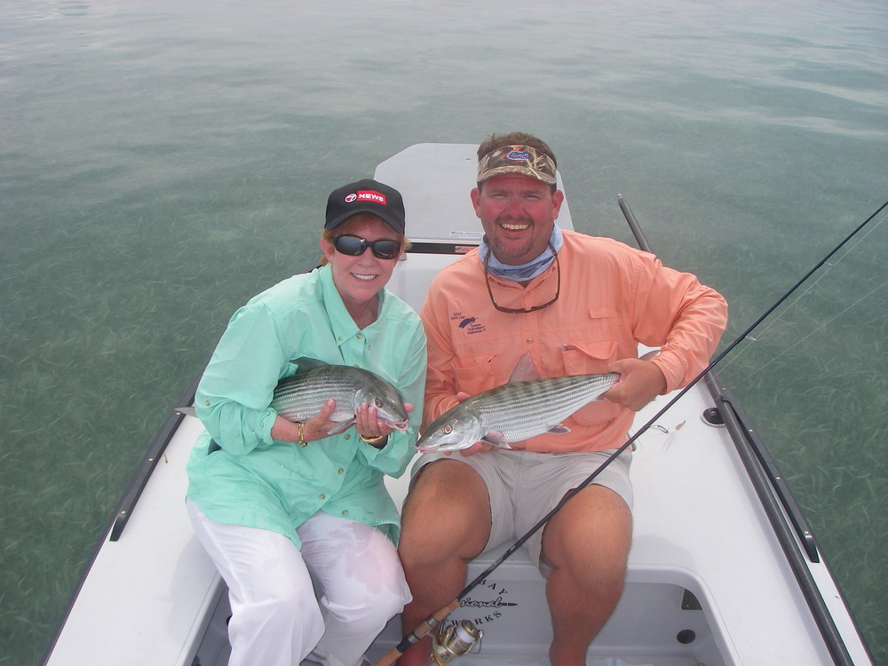 Investigative journalist Carmel Cafiero, left, and the author, right, with a pair of Keys bonefish prior to release in the Florida Keys National Marine Sanctuary.