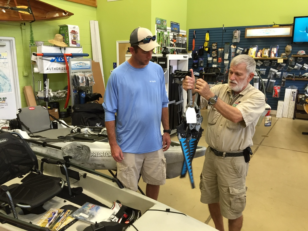 Kayak's by Bo owner Tom Atlif, right, demonstrates the Mirage Drive system by Hobie. KBB is one of the top speciality kayaking stores in the Southeast US. KBB Outfitters, the fishing arm of the shop is located next store.