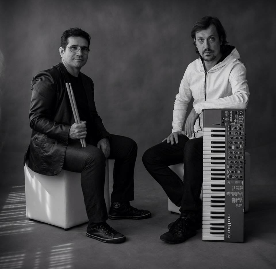"- Produced in 2014 by Lucio and his partner Ivo Senra, the ECO Music Project sparked uncanny bridges between subverted Brazilian folk, jazz and electronic vanguard. This unusual Synths/Drums duo presents a whole new outlook on just how innovative contemporary Brazilian music can be. Overlaying pulsations like the northeastern ""Boi"" or even the well-trodden Bossa-nova claves, with deep textural fat synths remind us of the more experimental moments of Radiohead. The ECO duo claims its seat on the tradition of crossover artists like Hermeto Pascoal and Egberto Gismonti.The first album called"