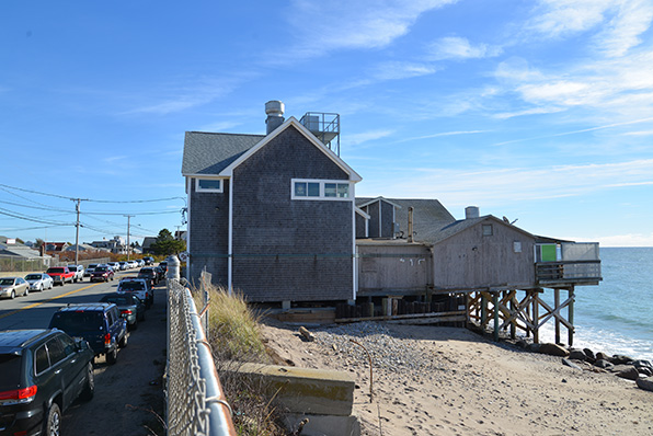 Homes and businesses, such as Ocean Mist, along a stretch of street in South Kingstown are caught between an encroaching sea and Matunuck Beach Road. (Joanna Detz/ecoRI News)