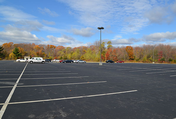 Twin River Casino in Lincoln has some 12 acres of parking, which included paving over more than 2 acres of a field at the edge of a wetland without town or state consent. (Joanna Detz/ecoRI News)