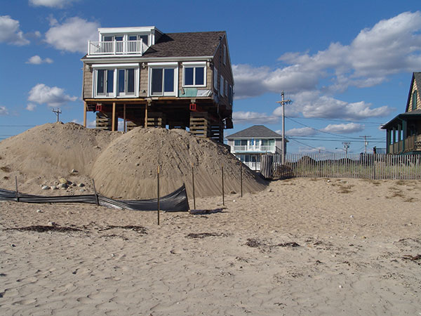 This beachfront house in Westerly is getting a lift. (Frank Carini/ecoRI News)