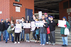 About 25 members of Bus Riders United rallied Nov. 20 outside the Southeastern Regional Transit Authority offices to demand Sunday bus service. (Joyce Rowley/ecoRI News)