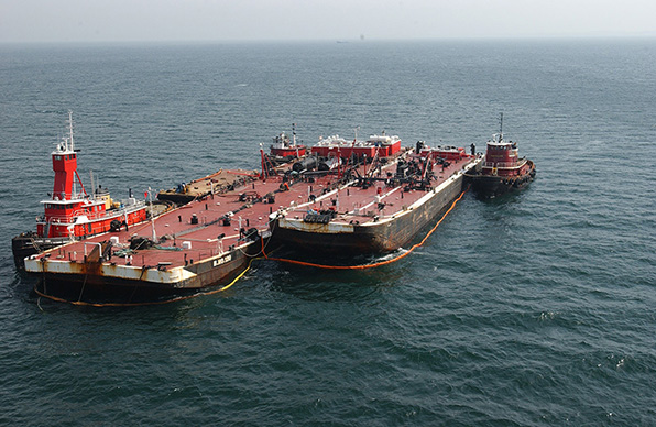 Bouchard Transport Co. barge being offloaded on April 27, 2003 after hitting a submerged object in Buzzards Bay, causing 98,000 gallons of oil to spill. (NOAA)