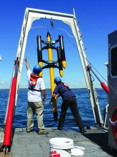 A wave-energy buoy created by URI and Electro Standards Laboratories can generate electricity for offshore and nearshore uses. (URI photos)
