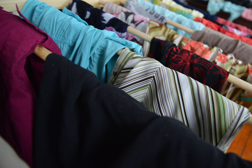 These are the real bargain racks. Gently used apparel is racked up at a recent clothing swap in Providence. (Joanna Detz/ecoRI News photos)