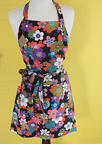 An upcycled apron made from vintage tablecloth.