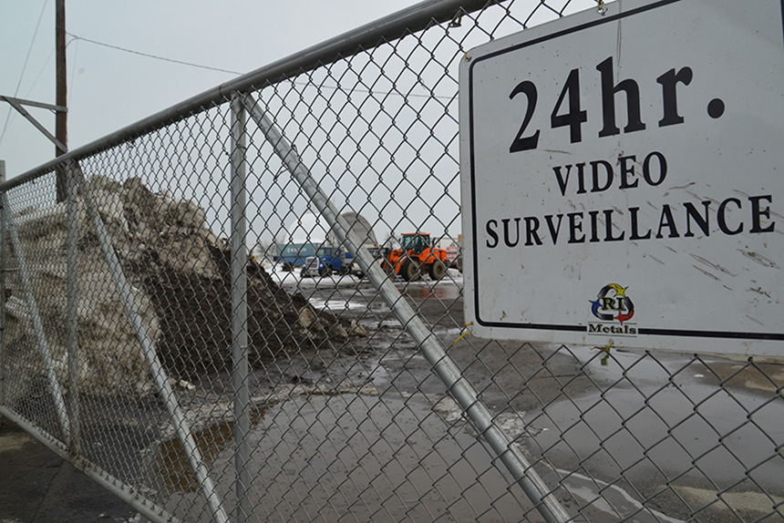Rhode Island Recycled Metals in Providence keeps an idea on people, but, at least according to state officials, the scrap yard on Allens Avenue doesn't pay much attention to stormwater runoff and other pollution problems. (Joanna Detz/ecoRI News)
