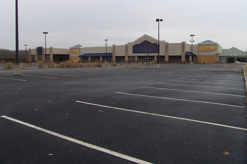 This 117,000-square-foot Lowe's superstore opened in mid-January 2009 on Davisville Road in North Kingstown, R.I. It was out of business by late 2011, costing some 100 people their jobs and leaving behind an enormous impervious footprint that exacerbates the pollution problem caused by stormwater runoff. This development monstrosity in the Quonset Business Park has been vacant for nearly twice as long as it was open. (Frank Carini/ecoRI News)