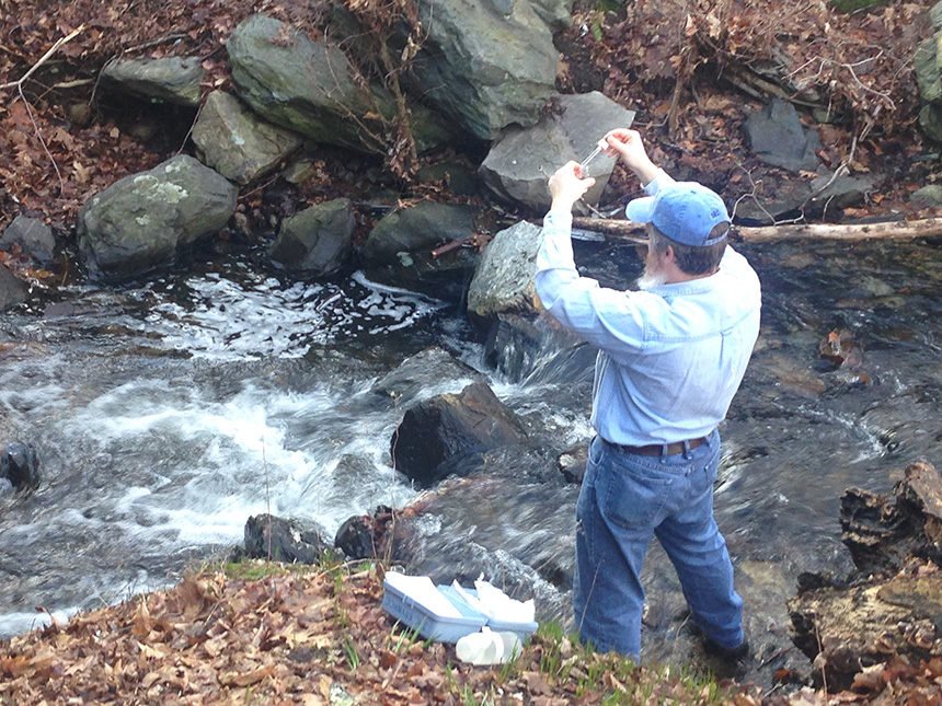 Blackstone River Coalition volunteer Michael Gravier took water samples from Mussey Brook in Lincoln, R.I., earlier this month. (Catherine Sengel/ecoRI News)
