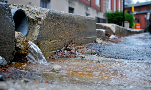 Impervious surfaces rush polluted water into important natural resources such as rivers and bays. (Chesapeake Bay Program)