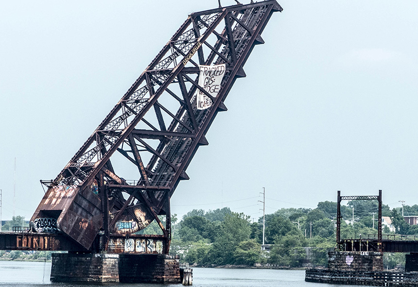 Activists attached a 'Fracked Gas: A Bridge to Nowhere' banner to the Crook Point Bascule Bridge in Providence to protest the expansion of a natural-gas pipeline and compressor station in Rhode Island. The June 12 protest was one of several across southern New England this week to counter plans to build and expand pipelines across the region. (FANG)