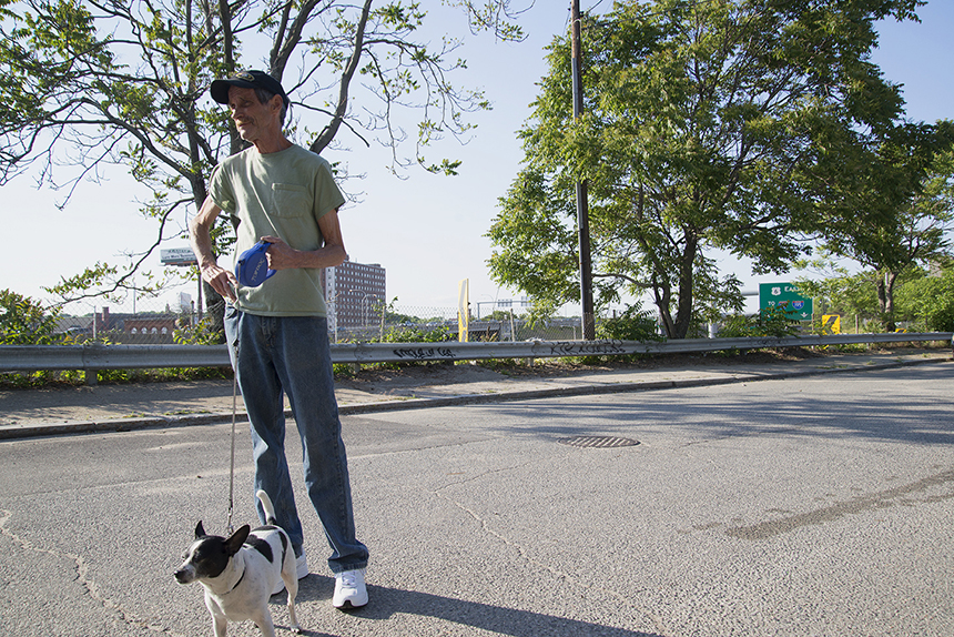 Providence resident Carl Titcomb, a close neighbor of the 6-10 Connector, would like to see the maze of highway torn down. He walks his dog daily on Service Road 1, a barren path of asphalt with no homes or businesses fronting it. (Joanna Detz/ecoRI News photos)