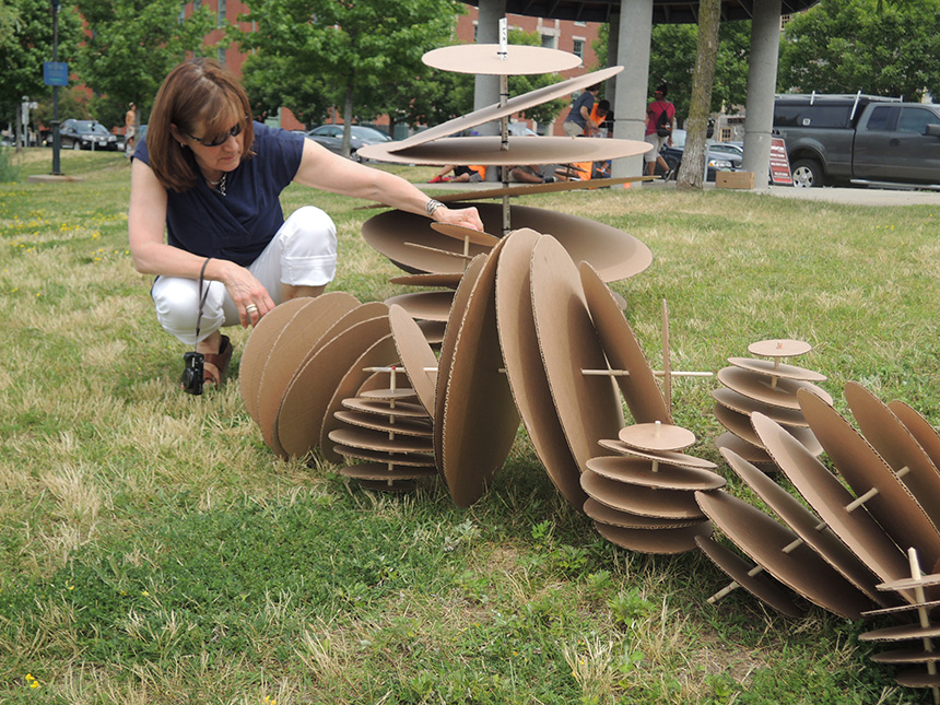Scheri Fultineer, one of the projects leaders, experiments with a cardboard version of an oyster reef prototype. The real prototypes will be made of more durable materials, mainly metal and concrete. (RISD)