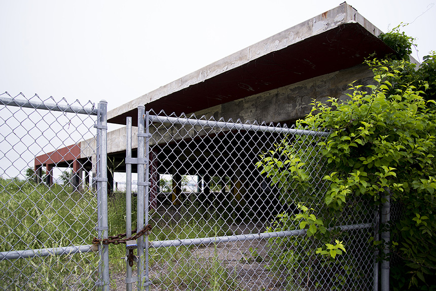 The long-vacant 'Shooters' site on the Providence waterfront is one of three locations David Dadekian is looking at as a possible home for his Eat Drink RI Central Market. 'It's a crime that the site is a vacant lot,' he says. (Joanna Detz/ecoRI News)