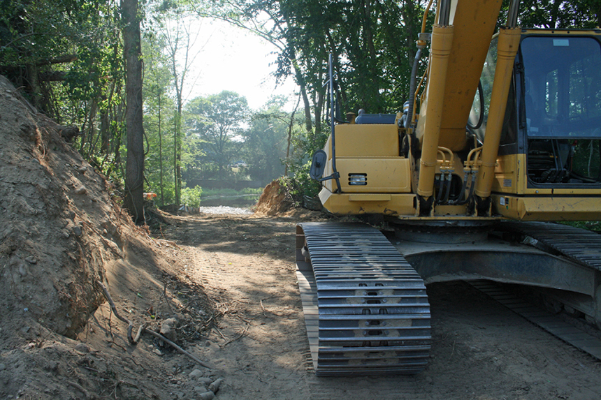 A view down the road carved through the woods from Cherenzia Excavation Inc. on the Rhode Island side of the Pawcatuck River. Building the road was the project's first step. (David Smith/ecoRI News photos)
