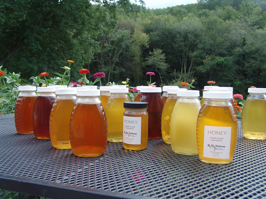 The local honey of Jon Nelson, of B.B. Nelson Apiaries in Woonsocket, R.I., ranges in color and taste. He gives most of it away to family and friends. He has hives at his Woonsocket home and at this farm in North Smithfield. (Frank Carini/ecoRI News)