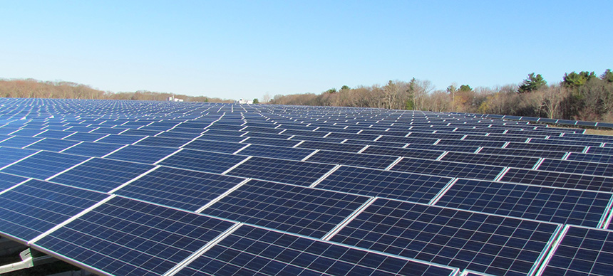 Some 13,000 solar panels sit atop a former landfill in East Providence. It's Rhode Island's first landfill solar project and the state's largest solar-energy system. (Tim Faulkner/ecoRI News)
