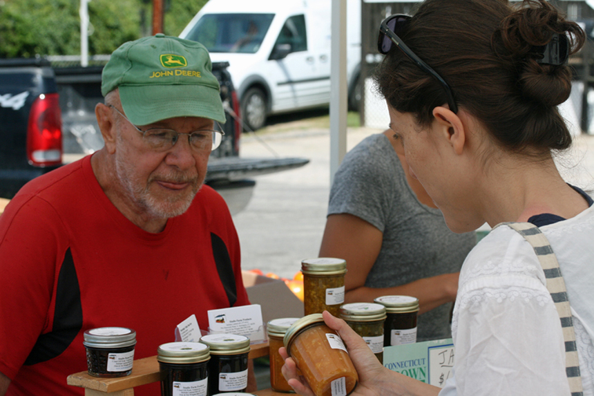 Dick Wingate helps a customer at a recent Stonington Farmers Market.