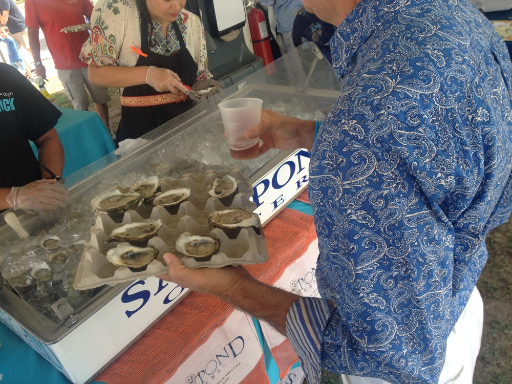 Attendees were issued compostable egg-carton trays in which to carry their oysters.