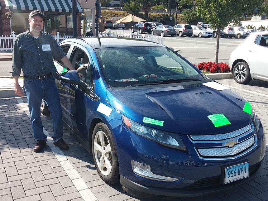 Mark Renburke, executive director of  Drive Electric Cars New England , said he can drive about 50 all-electric miles on a fully charged battery in his Volt — 15 miles farther than the EPA estimate. (Kevin Proft/ecoRI News)