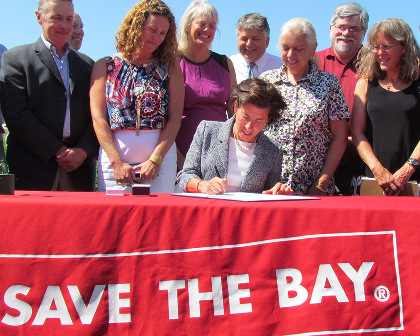 Since 1972 nine Rhode Island governors have signed a host of environmental bills into law, including a cesspool bill signed by Gov. Gina Raimondo this past summer during a ceremony held at Save The Bay's headquarters in Providence. However, enforcement of many environmental laws, such as heavy-machinery idling, business recycling, fugitive dust and littering, is terribly lax. (Tim Faulkner/ecoRI News)