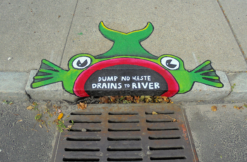 The Woonasquatucket River Watershed Council is working with artist and educator Brent Bachelder and The Met School to create storm-drain murals, such as this one in front of Donigian Park on Valley Street, along the Fred Lippitt Woonasquatucket River Greenway in Providence. (Brent Bachelder)