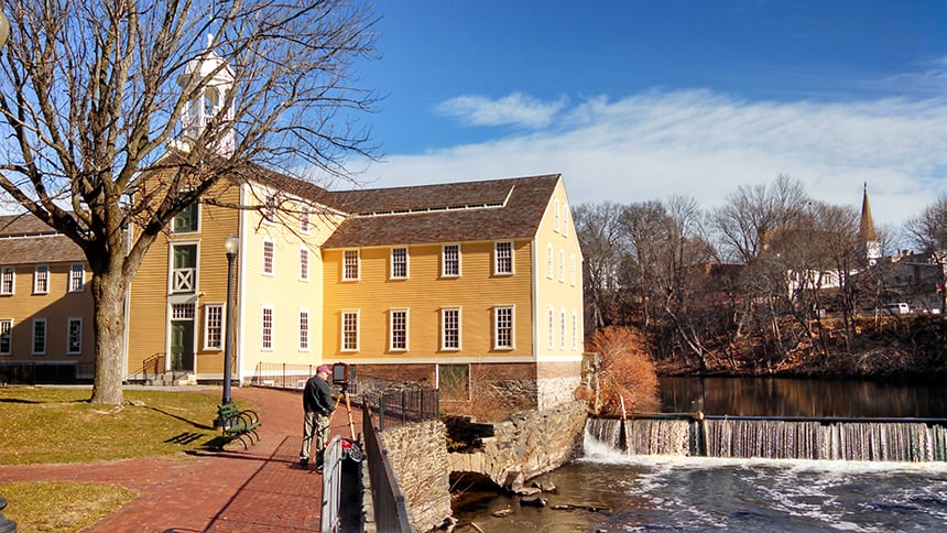 Water pours over a dam on the Blackstone River in Pawtucket, R.I., that helped power Slater Mill in the 18th and 19th centuries. (Kevin Proft/ecoRI News)