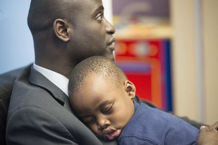 Omar Bah, with son Samba, was so overwhelmed by the kindness he enjoyed upon this arrival in Rhode Island that he's committed to helping other refugees build a home here. (Joanna Detz/ecoRI News photos)